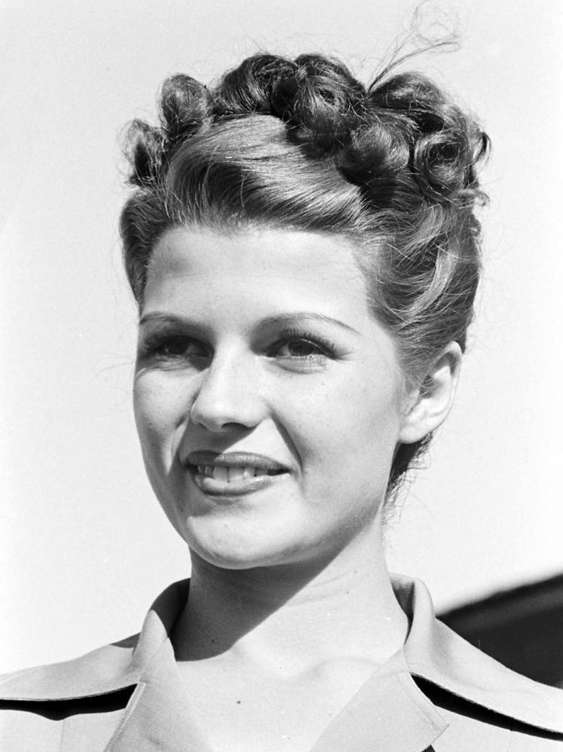 Rita Hayworth with classic updo – straight up with curls on top