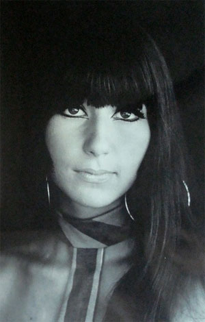 Cher with long locks and fringe