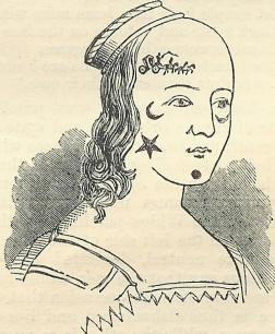 A rudimentary illustration from 1650 of a person wearing mouche, little shapes cut from velvet that were stuck on the face to disguise imperfections. There is a star, a moon, a circle, and a horse and carriage.